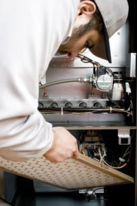 hvac tech performing furnace replacement in weatherford tx