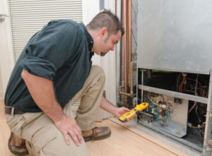 hvac technician performing furnace repair in aledo tx