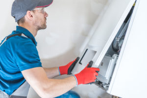hvac tech replacing boiler in weatherford tx